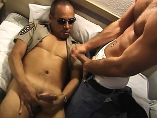 Kinky police officer exchanging blowjobs with his partner on the bed blowjob (gay) gays (gay) hunks (gay)